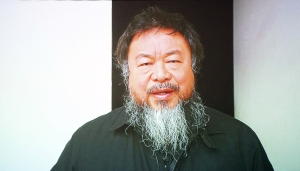 Chinese dissident artist Ai Weiwei, member of the jury, is pictured on a screen as he announces from China the winners of the 18th edition of the Hivos Tiger Awards in Rotterdam, in the Netherlands, on February 1, 2013. (Courtesy Getty Images)