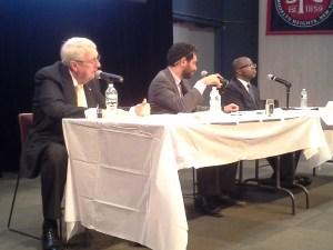 Brooklyn DA Charles Hynes and Kenneth Thompson, with moderator Harry Siegel between them.
