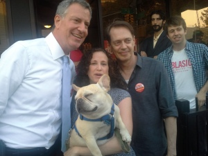 Bill de Blasio poses with actor Steve Buscemi and a voter outside Southside Coffee.