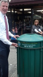 Bill de Blasio posing for a photo next to his trash can.