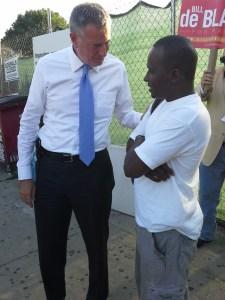 Bill de Blasio talks to a voter.