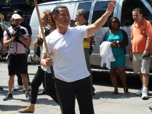 John Liu playing stickball during the mayoral campaign.