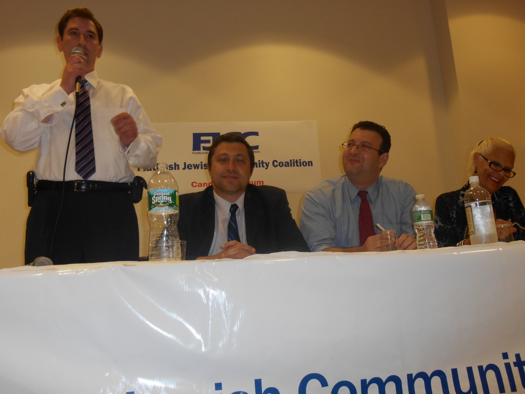 Chaim Deutsch rises to denounce his Democratic rivals.