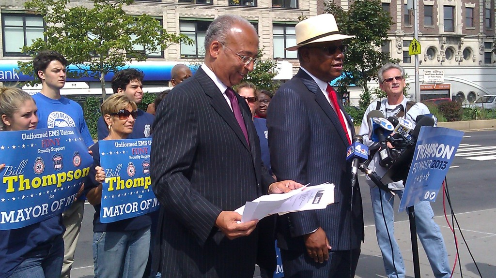 Uniformed EMS Officers Union stand behind mayoral candidate Bill Thompson during today's event.