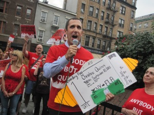 Anti-Quinn activist Donny Moss with Ms. Quinn's pretend parting gifts.
