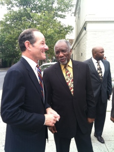 Eliot Spitzer speaking with Rev. Youngblood