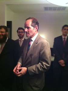 Spitzer taking heat from the audience.