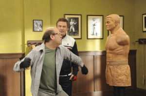 Mr. Adsit, as Pete Hornberger, gets physical in a scene with Alec Baldwin's Jack Donaghy. (NBC)