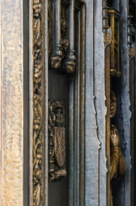 The ornate doors bear bronze castings of saints. (Fernando Gomes)