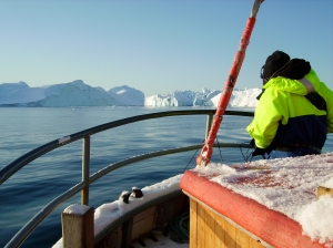 Field photograph of Jana Winderen recording in  Disco Bay, Greenland, in 2007. (Courtesy the artist)