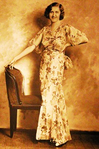 Friends and the few relatives who knew her described her as shy but not sad. Here she poses in a Japanese print dress at about age 37. The Estate of Huguette M. Clark, from the book Empty Mansions.