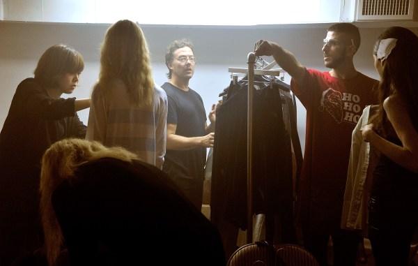 J. Crew alumnus Tim Hamilton backstage during a fashion show.