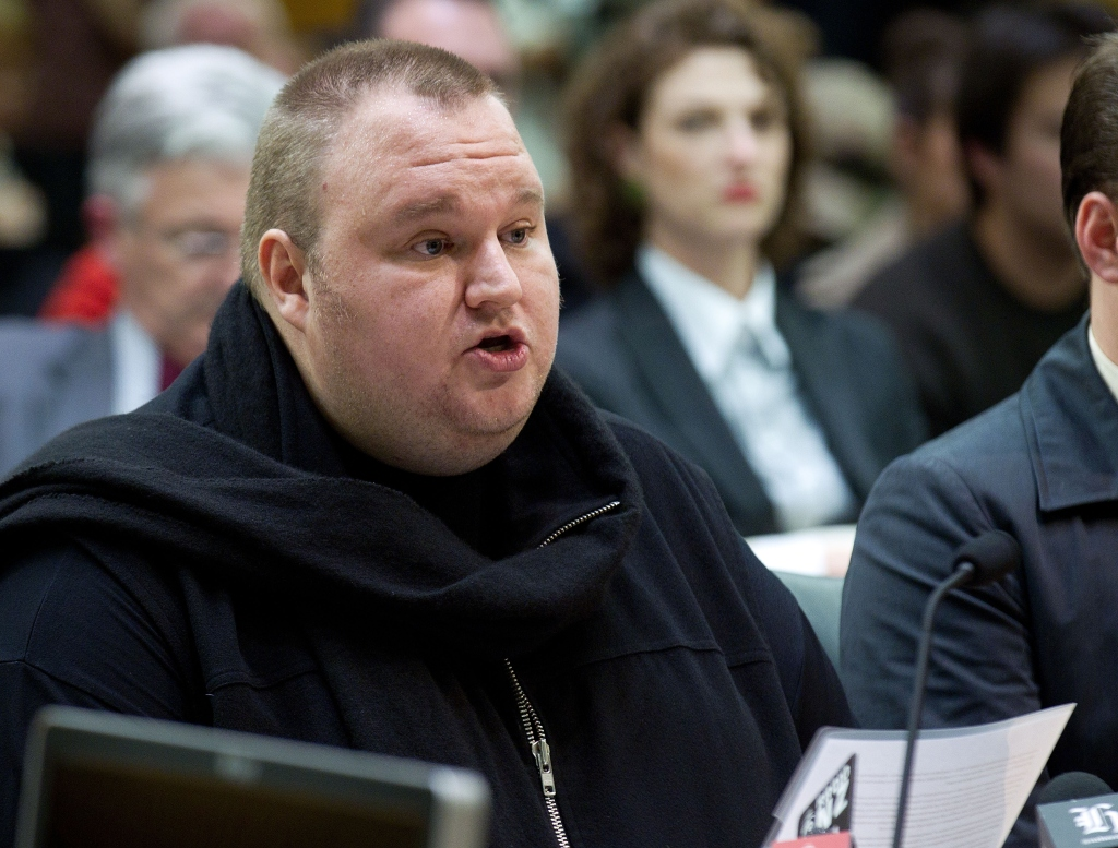 """""""Senator Dotcom, could you PLEASE stop grandstanding?"""" (Photo credit should read Marty Melville/AFP/Getty Images)"""