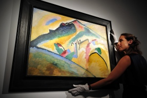 A Kandinsky being handled at Christie's London last week. (Photo by Carl Court/AFP/Getty Images)