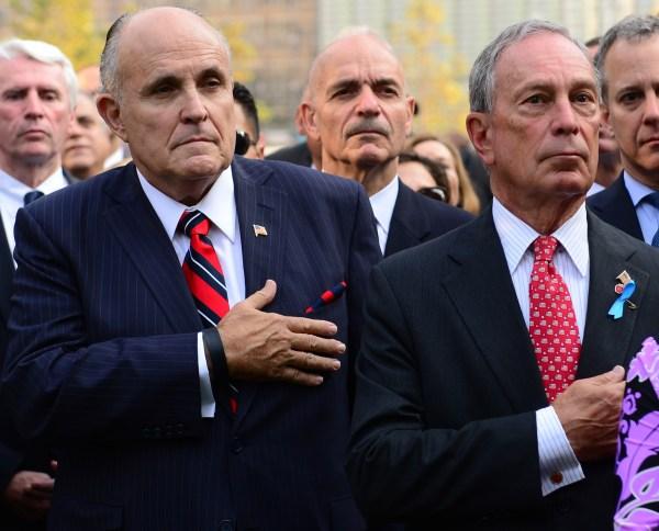 Former New York mayor Rudy Giuliani alongside outgoing New York mayor Michael Bloomberg. (David Handschuh/New York Daily News/POOL)