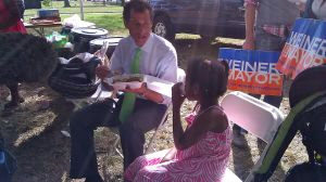 Anthony Weiner speaks to five-year-old Jayanna Magnus during a cricket match in south Queens today.
