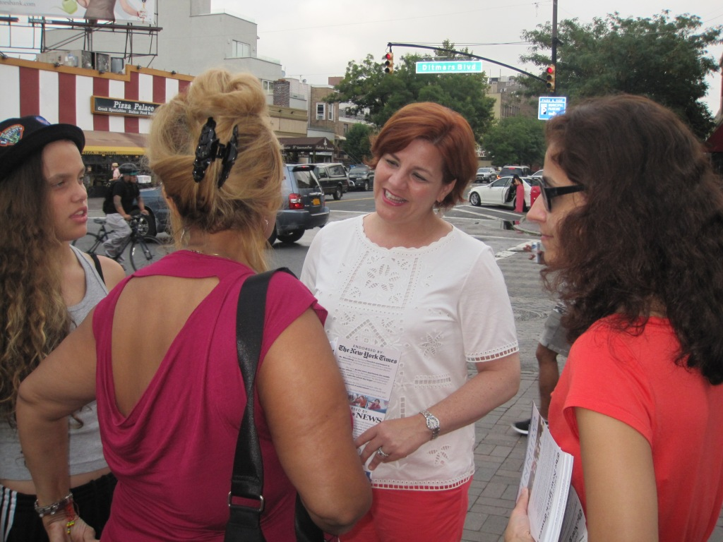 Christine Quinn chatting with voters in Astoria yesterday evening.