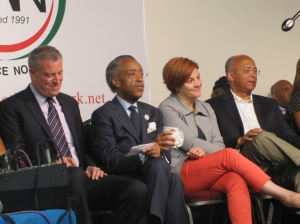 The candidates on stage at the National Action Network.