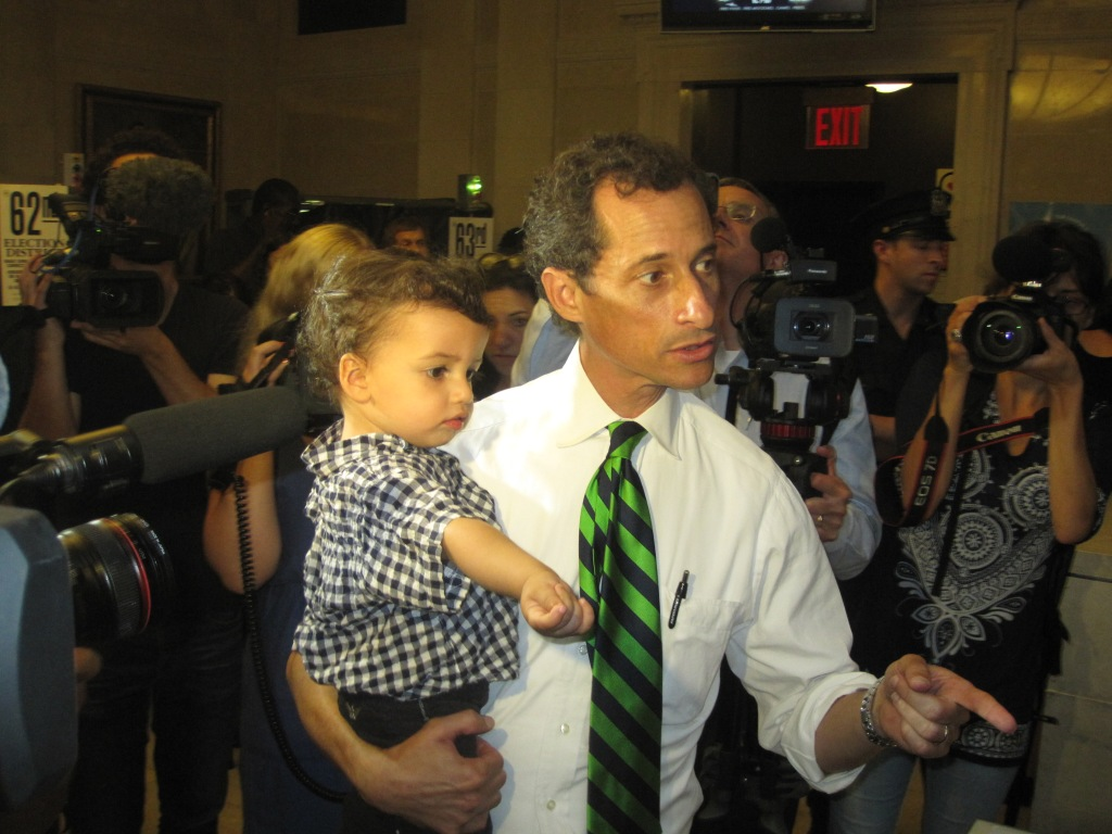 Anthony Weiner votes with his son, Jordan.