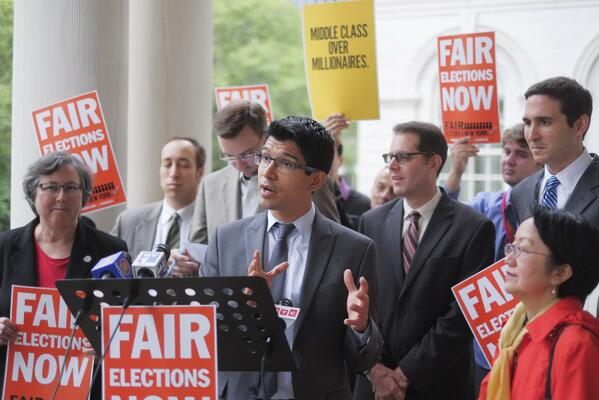 City Council candidate Carlos Menchaca speaking with other Democratic nominees.