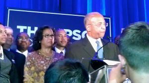 Bill Thompson standing beside his wife on stage tonight.
