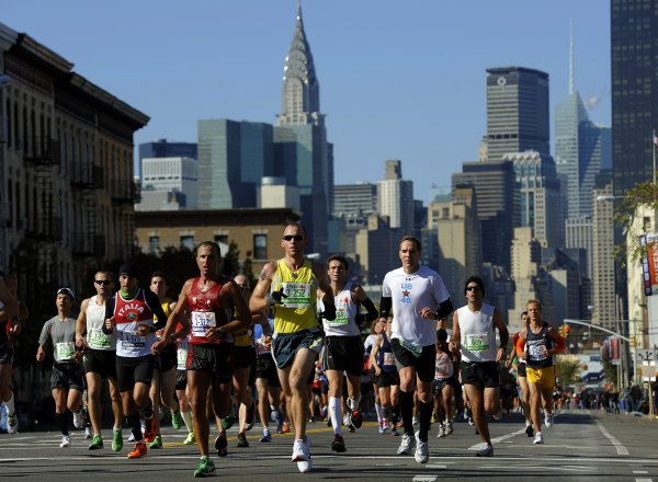 Runners make their way through Queens. (Photo by TIMOTHY A. CLARY/AFP/Getty Images)