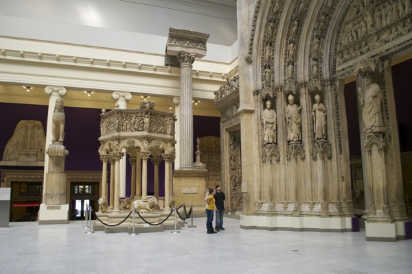 The museum's Hall of Architecture with purple walls and subtle architectural interventions by Gabriel Sierra.