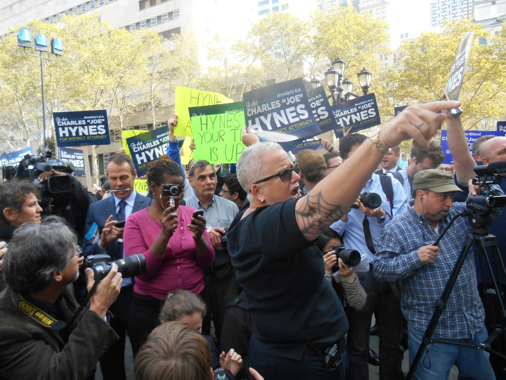 Charles Hynes and Ken Thompson supporters clash at Brooklyn Borough Hall.
