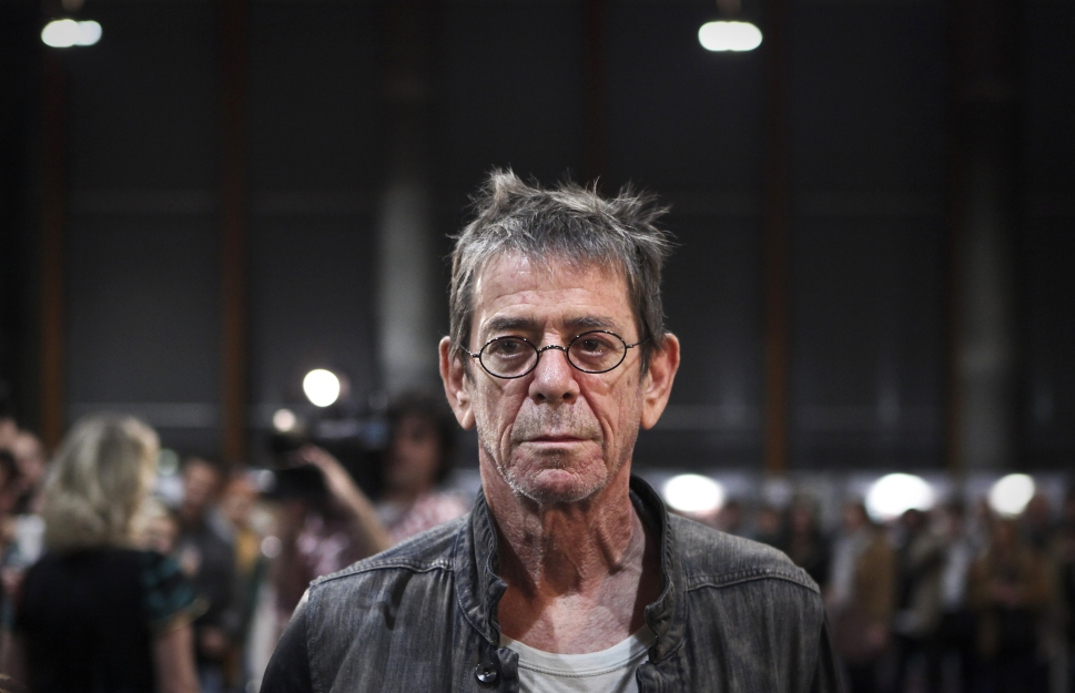 """At the opening of his photographic exhibition, """"Romanticism,"""" at the Congress Center in Estoril, outskirts of Lisbon, on November 5, 2010. (PATRICIA DE MELO MOREIRA/AFP/Getty Images)"""
