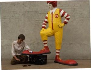 """Shoeshine"" by Banksy. (Banksyny.com)"