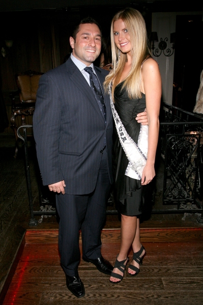 Gennaro Pecchia takes time out from his tubers for a photo with former Miss New York Amber Collins. (Photo: Getty)