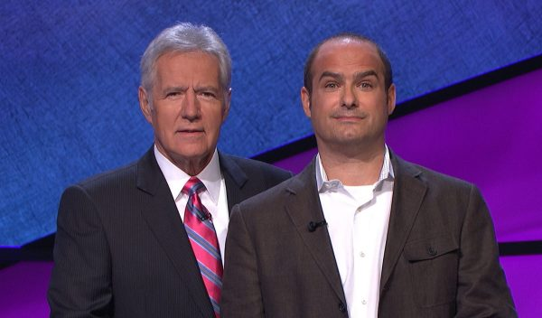 BFFs Alex Trebek and Neal Pollack post on the set of Jeopardy