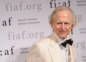Tom Wolfe moves papers down the street for millions. (Getty)