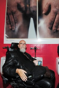 Chuck Close beneath a penis.