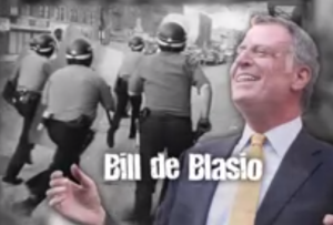 Bill de Blasio laughs as riots occur.