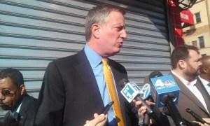 Bill de Blasio speaking with reporters today.