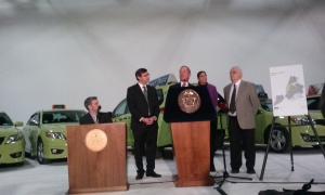 Mayor Bloomberg and one of his green apple cabs.