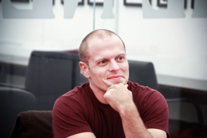 Tim Ferriss watches the premiere of his new show at The Observer offices. (Amanda Lea Perez)