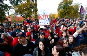 """Red Sox fans celebrate their victory in the 2013 World Series with a sign that reads """"THIS IS OUR BLEEP CITY!"""" (Photo: Jared Wickerham/Getty)"""