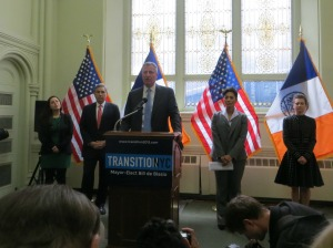 Bill de Blasio and the leaders of his transition team.