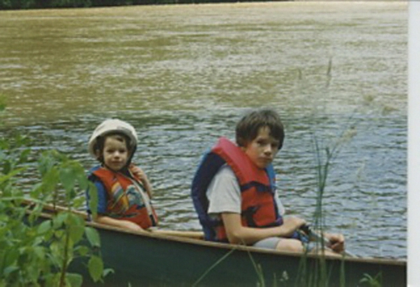 The author and his brother having an absolutely thrilling time in a canoe.