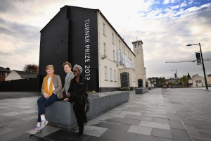 Ms. Prouvost (L) with David Shrigley and Lynette Yiadom-Boake. (Courtesy Getty Images)