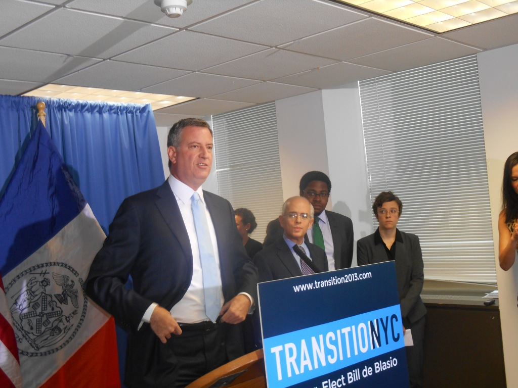 Bill de Blasio with his new high-ranking staffers, Anthony Shorris, Dominic Williams and Emma Wolfe.