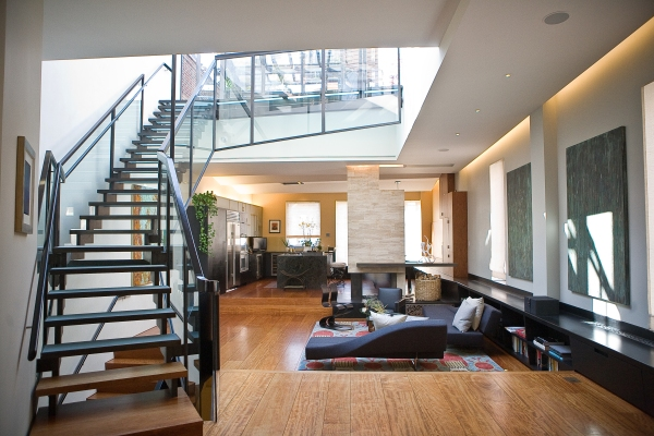 The kitchen and living room comprise the second floor, with stairs leading to the rooftop. (Photo by Emily Anne Epstein)