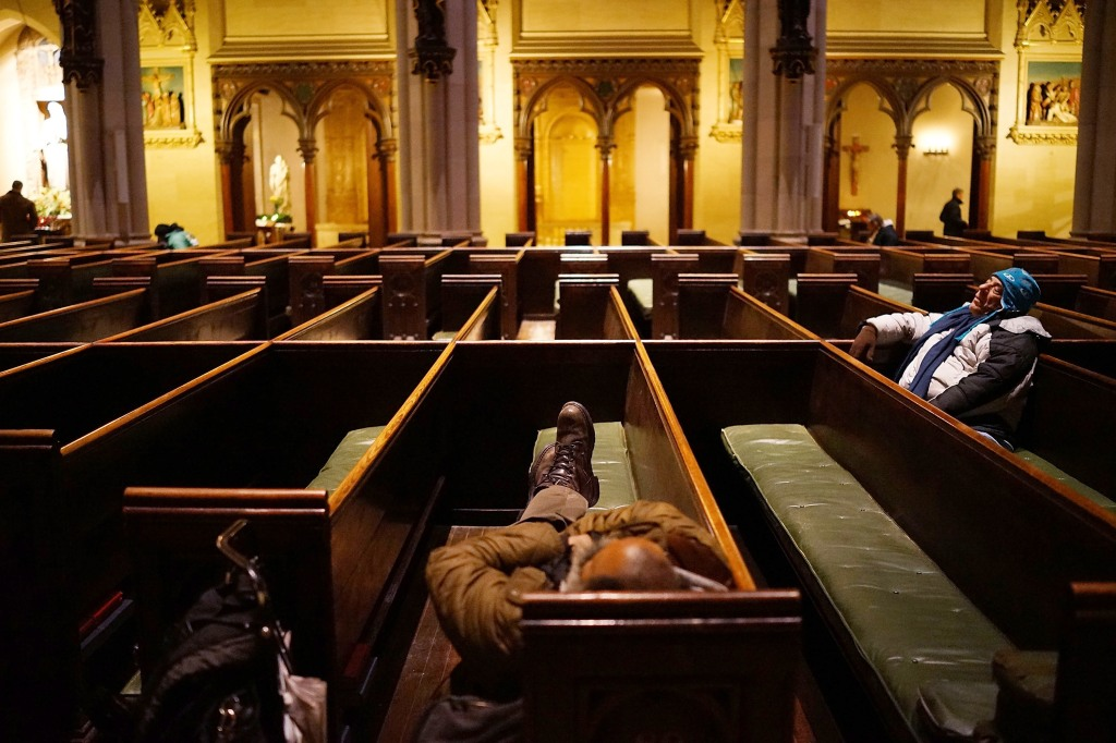Homeless take refuge fromt he cold at a Times Square church earlier this year. (Photo: Spencer Platt/Getty)