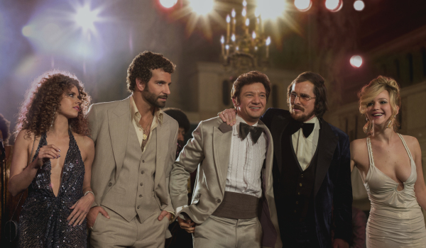 Left to right: Amy Adams, Bradley Cooper, Jeremy Renner, Christian Bale and Jennifer Lawrence in American Hustle.