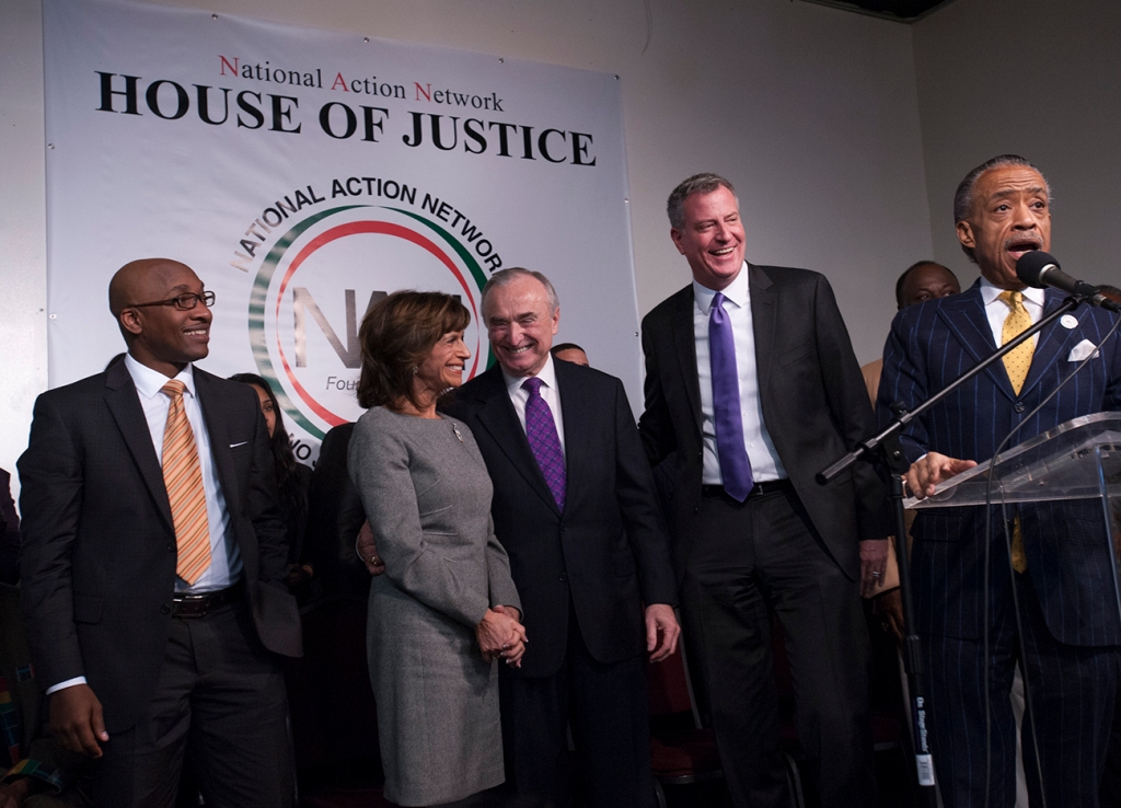Al Sharpton with Mayor-elect Bill de Blasio and incoming Police Commissioner Bill Bratton at the National Action Network. (Photo: WIlliam Alatriste)