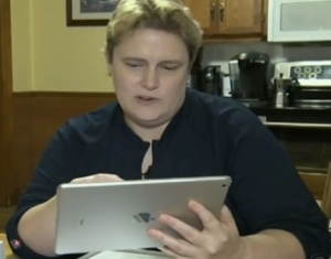 Robin and her crappy ass used iPad. (Screengrab: CTV)
