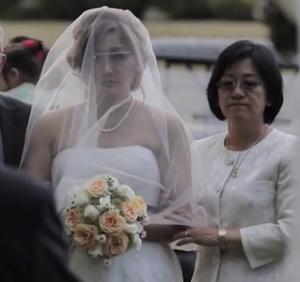 She looks thrilled. (Screengrab: okglassido.com)