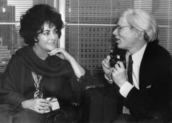 Elizabeth Taylor and Warhol in 1978 at Halston's. (AFP/Getty Images)